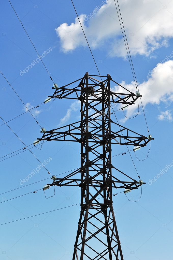 Mast of high voltage electric line on blue sky background — Stock Photo #5880017