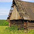 Old abandoned destroyed wooden barn — Stock Photo