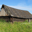 Old abandoned wooden barn — Stock Photo