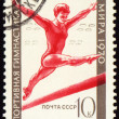 Post stamp shows female gymnast on balance beam — Stock Photo #6159448