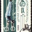 Post stamp shows gymnast on rings — Stock Photo