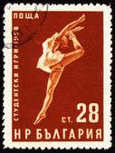 Tanec mladá žena na poštovní známce — Stock fotografie