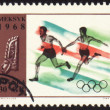 Stock Photo: Relay race on post stamp of Poland