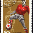 Footballer on post stamp - Stock Photo