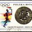 Sportsman with torch on post stamp of Poland — Stock Photo