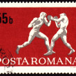 Fighting of two boxers on post stamp — Stock Photo
