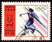 Javelin throwing on post stamp of Poland — Stock Photo