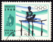 Gymnast on post stamp of Poland — Stock Photo