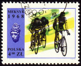 Group of cyclists on polish post stamp — Foto Stock