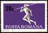 Javelin throwin on post stamp — Stockfoto