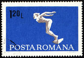 Diving swimmer on post stamp — Foto Stock