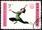 Figure skating on post stamp — Stock Photo