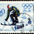Ski jumper on post stamp - Stock Photo