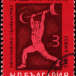 Heavy athletics on post stamp — Stock Photo #6339373