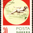 High jump on post stamp — Stock Photo