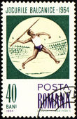 Javelin throwing on post stamp — Stock Photo
