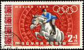 Jockey riding horse on post stamp — Stock Photo