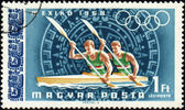Rowing on post stamp — Stock Photo
