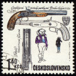 Ancient pistol on post stamp — Stock Photo