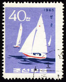 Yachts in a sea on post stamp — Stock fotografie