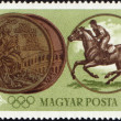 Stock Photo: Sportsmriding horse and Olympic medal on post stamp