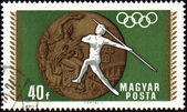 Javelin throwin and Olympic medal on post stamp — Stock Photo