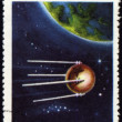 "图库照片: Post stamp with first russisatellite ""Sputnik-1"""