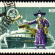 Passenger ship and man in national Mongolian costume on post stamp — Stock Photo