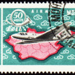 Flying air liner and map of Mongolia on post stamp — Stock Photo