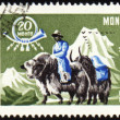 Post stamp with man in national Mongolian costume on yak — Stock Photo