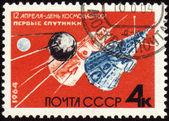 Premiers satellites soviétiques sur le cachet de la poste — Photo