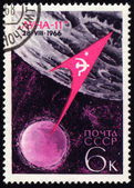 "Flight of soviet automatic spaceship ""Luna-11"" on post stamp — Stock Photo"