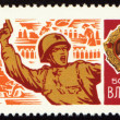 Soviet officer with a pistol in battle on postage stamp — Stock Photo