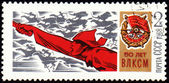Red Army Man with a sword on postage stamp — Stock Photo