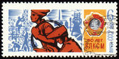 Young workers on postage stamp — Stock Photo