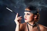Smoking retro-styled sexy lady — Stock Photo