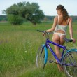 Stock Photo: Sexy girl with bicycle