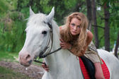 Charming horsewoman — Stock Photo