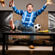 Soccer fan on sofa — Stock Photo #5451197