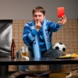 Soccer fan on sofa — Stock Photo #5451214