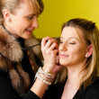 Stock Photo: Doing make-up