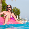 Woman at poolside — Stock Photo #5596843