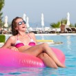 Woman at poolside — Stock Photo #5596852