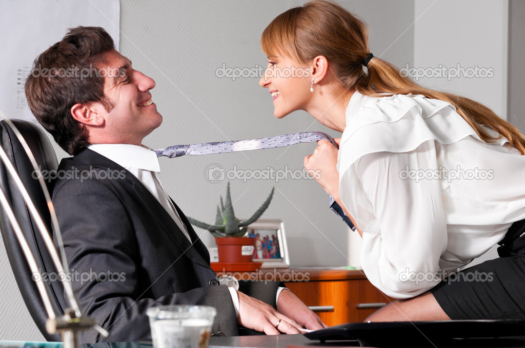 Businesswoman is seducing her boss at office — Stock Photo #5644187
