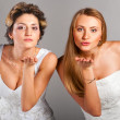 Beautiful brides is blowing kisses — Stock Photo