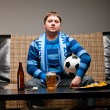 Soccer fan on sofa — Stock Photo #5661979