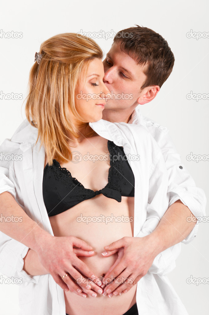 Man and his pregnant wife are embracing. — Stock Photo #5661901