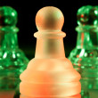 Stock Photo: Red and green glass chess pieces