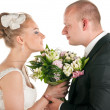 Wedding couple are holding bridal bouquet — Stock Photo