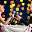 Bride and groom at cafe — Stock Photo #5748473